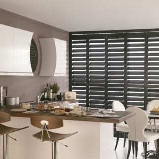 Modern kitchen with dark shutters