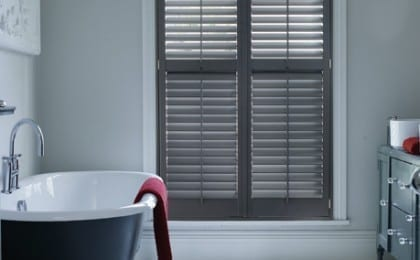 Dark shutters in modern bathroom