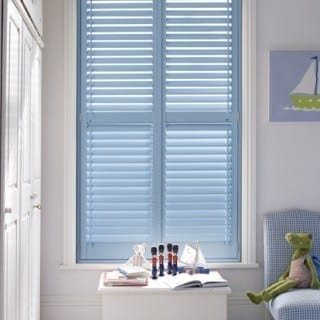 Blue shutters on white wall