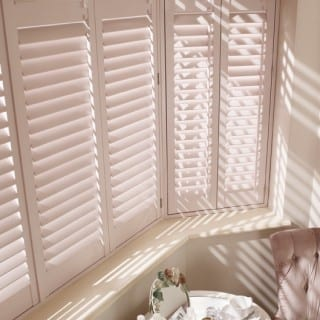 Close up of off-white shutters
