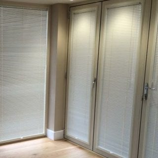 Multiple venetian blinds