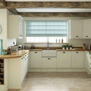 Bright kitchen with blue roller blind