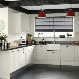 Dark blind and exposed beams in kitchen