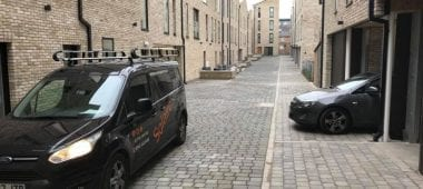 housing alley with cars