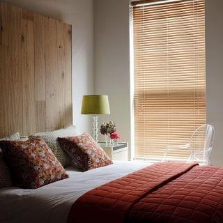 Wooden blinds in the bedroom