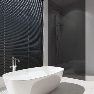 Gloss black venetian blinds in a bathroom
