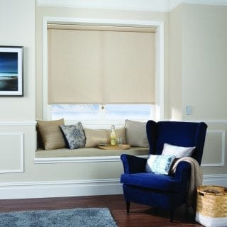 Beige motorised roller blind in bay window
