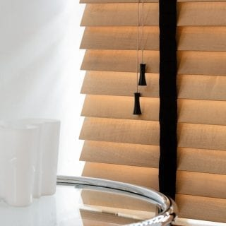 Tawny wood venetian blinds with black jet tapes