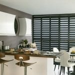 Dark coloured shutters in a modern kitchen