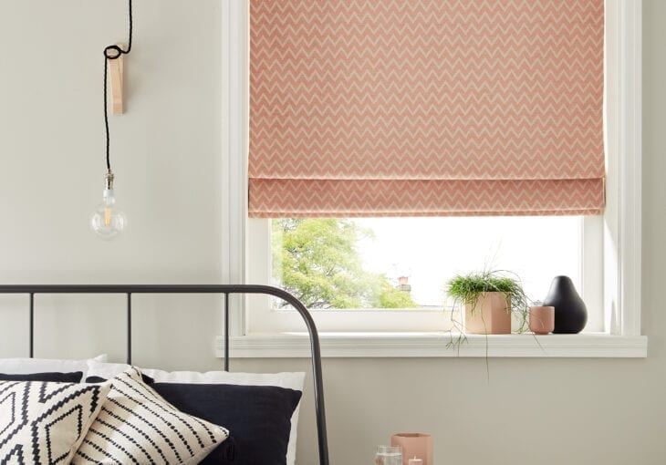Arena Rom Otto Salmon Roman Blinds in a bedroom