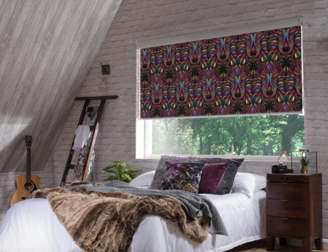 Aslan Blackout Rainbow roller blinds in a bedroom