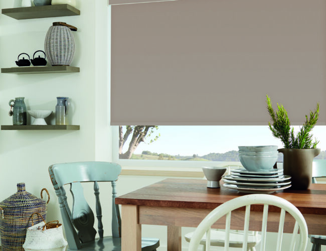 Carnival Clay roller blinds in a dining area